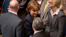 B.C. Premier Christy Clark, centre, makes her way to her seat before Lieutenant-Governor Judith Guichon delivers the Throne Speech at the B.C. Legislature in Victoria on Feb. 12, 2013. (Darryl Dyck/The Canadian Press)