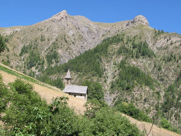 A church nestled in rugged country on the climb of the Col d'Allos, in Les Alpes-de-Haute-Provence, on day 7.