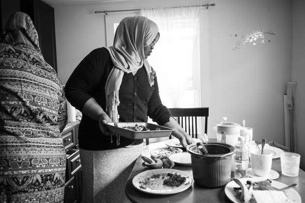 Refugee claimant Asha Ahmed came to Canada two months ago. She was once the acting minister for women's rights for Puntland state in Somalia, before her life was threatened by al-Shabaab. She now lives in Winnipeg while she waits for her refugee claim hearing. Here, she cleans up after lunch in the apartment that she shares with other asylum seekers.