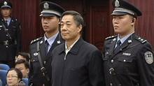 Bo Xilai (C) stands as the decision of his appeal is announced at the Shandong Higher People's Court in Jinan, capital of east China's Shandong Province in this still image taken from video October 25, 2013. (REUTERS TV/REUTERS)