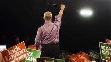 NDP Leader Jack Layton raises his cane to the crowd at a campaign rally in Burnaby, B.C. on Saturday, April 30 (Andrew Vaughan/THE CANADIAN PRESS)