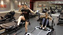 Instructor Leila Panjvani leading a workout class at Studio Lagree in Toronto. (Fernando Morales/The Globe and Mail)