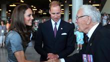 Catherine, Duchess of Cambridge, accompanied by her husband Prince William, shakes hands with Royal Canadian Navy veteran Lieutenant Kenneth Mathewson-Porter during a visit to the Canadian War Museum in Ottawa. (JOHN STILLWELL/REUTERS)