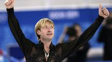 Evgeni Plushenko of Russia gestures after competing in the men's team free skate figure skating competition at the Iceberg Skating Palace during the 2014 Winter Olympics, Sunday, Feb. 9, 2014, in Sochi, Russia. (Bernat Armangue/AP)