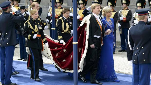 Dutch King Willem-Alexander and his wife Queen Maxima arrive at Nieuwe Kerk church before the religious crowning ceremony in Amsterdam April 30, 2013. Queen Beatrix of the Netherlands abdicated on Tuesday, handing over to her eldest son, Willem-Alexander, who became the first King of the Netherlands in over 120 years. (Dylan Martinez/Reuters)