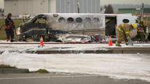 A small plane crash at the foot of the Vancouver International Airport in Richmond, B.C., on Oct. 27, 2011. (John Lehmann/The Globe and Mail)