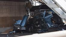 The damaged sustained to a bread truck after a dump truck crash that continues to shut down the Toronto-bound lanes of the Burlington Skyway bridge in Burlington, Ont., Friday, August 1. (Aaron Lynett/THE CANADIAN PRESS)