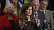Federal Health Minister Rona Ambrose addresses a press conference as Quebec Health Minister Réjean Hébert (far right), Alberta Health Minister Fred Horne and Ontario Health Minister Deb Matthews (left) look on following a meeting of Provincial and Territorial Ministers of Health Oct 4, 2013 in Toronto. (Moe Doiron/The Globe and Mail)