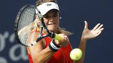 Aleksandra Wozniak of Canada hits a return against Alexandra Cadantu of Romania during their women's singles match at the U.S. Open tennis tournament in New York August 27, 2012. Wozniak won 6-0, 6-3. (EDUARDO MUNOZ/REUTERS)