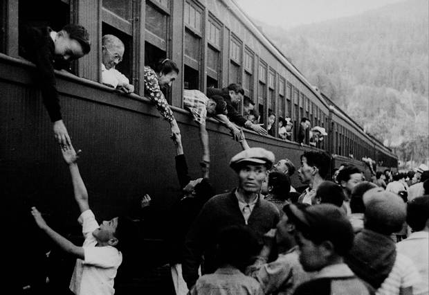 Japanese-Canadians are shown being relocated to camps in the interior of British Columbia in a photo taken between 1942 and 1946.