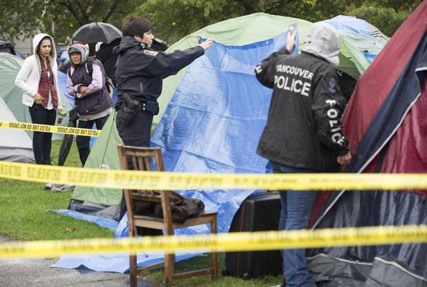 Police cover the tent where Joerg Brylla's body was found.