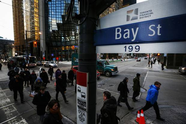 People walk down Bay Street in Toronto's Financial District in January of 2015.