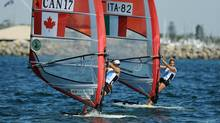 Nikola Girke of Canada and Veronica Fanciulli of Italy compete in the RS:X Women's Windsurfer event at the ISAF World Sailing Championships off Fremantle. (GREG WOOD/AFP/Getty Images)