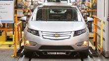 The first pre-production Chevrolet Volt rolls off the line at the Detroit-Hamtramck manufacturing plant in Detroit March 31, 2010. (HO)