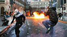 The influence of U.S. economists Carmen Reinhart and Kenneth Rogoff reached deep into public policy circles, providing intellectual ballast for the tough austerity and debt reduction measures imposed on the financially crippled members of the euro zone as a condition of their bailouts. Here, protesters hurl gasoline bombs during violent anti-austerity demonstration in central Athens February 12, 2012. (© Yannis Behrakis / Reuters/REUTERS)