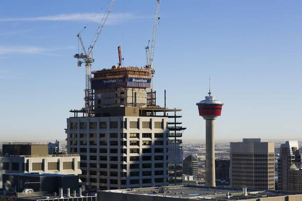 An office tower takes shape in Calgary, while demand for space continues to plummet.