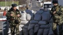 Ukrainian border guards stand at a checkpoint at the border with Moldova's breakaway Transnistria region, near Odessa, March 13, 2014. (Yevgeny Volokin/REUTERS)