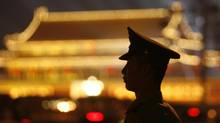 A file photo shows a paramilitary police officer keeping watch across at Tiananmen Square in Beijing. (CLARO CORTES IV/REUTERS)
