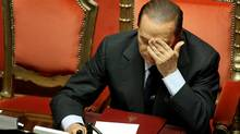 Italian Prime Minister Silvio Berlusconi reacts at a debate in the Senate on Monday, Dec. 13, 2010 in Rome. (Franco Origlia/Franco Origlia/Getty Images)