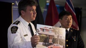 Inspector Brad Desmarais, left, and Jim Chu, Vancouver Police Chief Constable, discuss B.C.'s civil forfeiture program including one of the most valuable properties ever forfeited in the Lower Mainland during a press conference at City Hall in Vancouver, January 11, 2011.