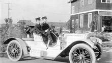 Chief Turner and Captain Munro of the Point Grey Fire Department take a ride in the fire chief's automobile in 1915. (UNKNOWN PHOTOGRAPHER/VANCOUVER ARCHIVES)