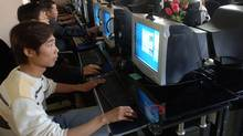 People use the computers at an internet cafe in Hefei, capital of China's Anhui province April 26, 2006. (STRINGER/CHINA/REUTERS)