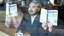 Author Kevin Chong sits in a coffee shop near his home in Vancouver, Oct. 18, 2011. (As two others read his latest book). (Jeff Vinnick/Jeff Vinnick-The Globe and Mail)
