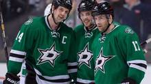 Dallas Stars centre Rich Peverley, far right, with captain Jamie Benn and Tyler Seguin, druing an NHL game on March 6, 2014. Peverley collapsed on the bench March 10. (Jerome Miron/USA Today Sports)