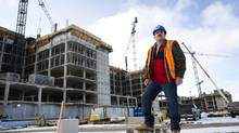 As a senior estimator for EllisDon, Mr. Fisher analyzes the client's construction needs, estimating the costs of materials, labour and specialized trade work. (Kevin Van Paassen/The Globe and Mail)