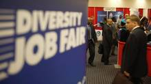 Attendees carry their resumes as they arrive at a job fair in a Washington hotel in this file photo (JASON REED/REUTERS)