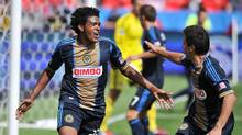 Philadelphia Union Sheanon Williams, left celebrates scoring a goal against Toronto FC during the second half of a game in Toronto Saturday September 15, 2012. (Aaron Vincent Elkaim/THE CANADIAN PRESS)