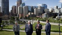 Minister of Environment and Sustainable Resource Development Robin Campbell, left, Alberta Premier Dave Hancock, Calgary Mayor Naheed Nenshi and Associate Minister of Public Safety and for Recovery & Reconstruction discuss the province's flood recovery and mitigation efforts during a news conference in Calgary on Tuesday. (Larry MacDougal for The Globe and Mail)