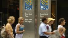 People walk past the Royal Bank Tower where the RBC Financial Group's Head Office and Main Bank Branch are located. (Louie Palu/The Globe and Mail)