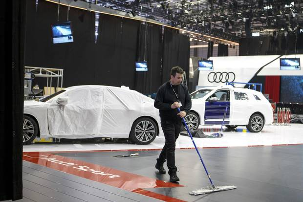An employee works at the Audi booth during the last preparations at the 88th Geneva International Motor Show, in Geneva, Switzerland, March 3, 2018.