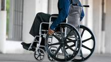 Side view of man in wheelchair (Jupiterimages/Jupiterimages)