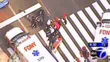 In this frame grab from WABC-TV, emergency personnel respond to reports of several people being shot outside the Empire State Building, Friday, Aug. 24, 2012, in New York. (AP/WABC-TV)
