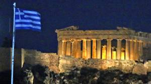 A Greek flag flutters near the Acropolis in Athens on June 15, 2012. (YANNIS BEHRAKIS/REUTERS)