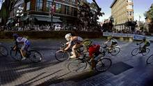 Cyclists taking part in the women's leg of the Tour de Gastown turn a corner during their 30-lap 36-km race in Vancouver, British Columbia, July 20, 2005. The annual cycling road race runs along cobbled streets in the city's historic Gastown area. (ANDY CLARK/REUTERS)