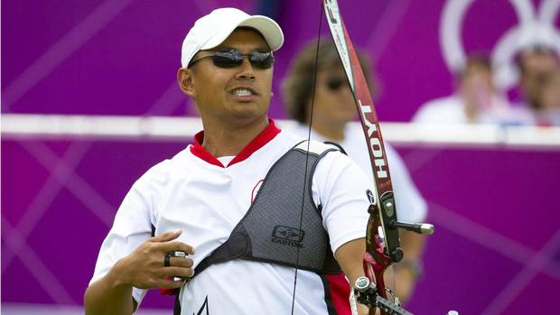 Canada's Crispen Duenas grimaces after a shot in the archery competition at the 2012 Summer Olympic Games in London, England, Monday, July 30, 2012. (Kevin Van Paassen/The Globe and Mail)