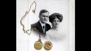 wedding photo of Hudson J.C. Allison and his wife Bess with coins found in his suit. Together with their children Lorraine and Hudson Trevor were all aboard the Titanic as first class passengers. He lived in Canada but had sailed to England for business. Like many others, they had altered travel plans to sail back with on the Titanic. After the Titanic struck the iceberg, Bess was unwilling to get into a lifeboat because she couldn't find her son Hudson Trevor. Unbeknownst to the family, Hudson Trevor was already on a lifeboat with his nurse Alice Cleaver. By the time, the family realized it, there were no lifeboats left for them. All three perished, and only Hudson Allison's body was recovered.