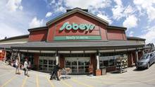 A Sobeys store in Calgary. Shares of Canada's three big grocery chains rose Thursday after Sobeys bought Safeway Canada. (Todd Korol for The Globe and Mail)