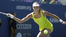 Serbia's Ana Ivanovic returns a shot to Sweden's Sofia Arvidsson in the second round of play at the 2012 US Open tennis tournament, Thursday, Aug. 30, 2012, in New York. (Mike Groll/AP)
