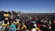 Striking platinum miners attend a rally near Lonmin's Marikana mine April 29, 2014. Members of South Africa's striking mining union AMCU have rejected the latest wage offer from the world's top three platinum producers, its president said on Tuesday, in an extension of the 14-week stoppage. (Mike Hutchings/Reuters)