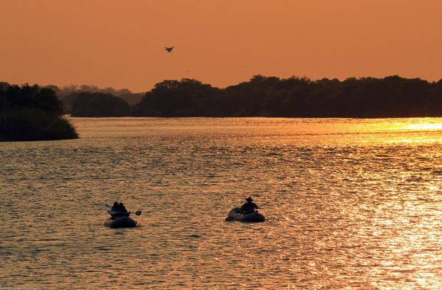 The Zambezi traces the border between Zambia and Zimbabwe, providing fleeting glimpses of day-to-day life on the famous river.