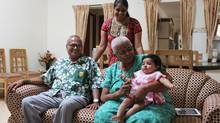 Gayatri Bhasker, standing, brings her new daughter Aadhya to visit her parents S.K., left, and Revathi at their villa in one of India's few communities for senior citizens, near Coimbatore, in Tamil Nadu. (Stephanie Nolen for The Globe and Mail)