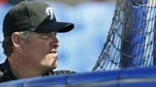 """Toronto Blue Jays manager John Farrell took over the Toronto Blue Jays with zero experience as a manager anywhere in the major or minor leagues. That has its upside, he said.""""I'm coming into this situation with a clean slate,"""" he said. """"I don't have a lot of preconceived notions, preconceived restrictions on things that I might see or look to do inside a game."""" Farrell is shown watching batting practice from behind the cage before a spring training baseball game against the New York Yankees at Florida Auto Exchange Stadium in Dunedin, Fla., Friday, March 11, 2011. (Kathy Willens/AP)"""