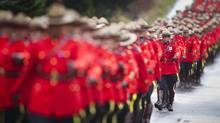 RCMP from across Canada march to a regimental funeral for RCMP constable Adrian Oliver in Langley, B.C. (John Lehmann/The Globe and Mail)