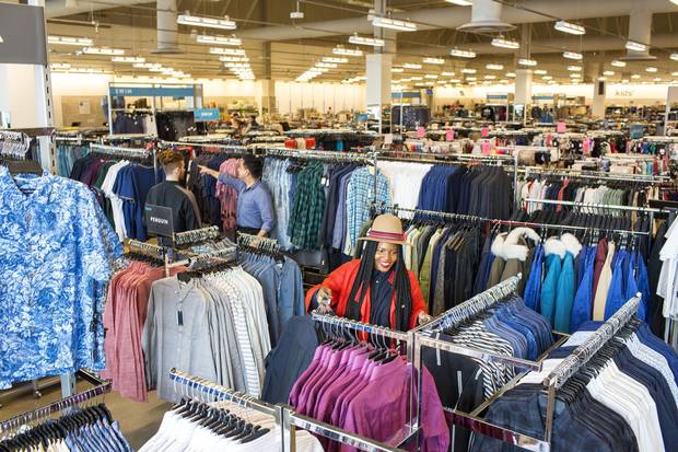 Workers prepare for the opening of the Nordstrom Rack store in Vaughan Mills, Ont., on Thursday. The site is one of six Canadian stores the company aims to open in 2018.
