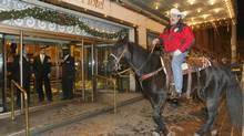 Calgary Stampeder mascot Joker and his rider Mark Dobrindt were refused entry by security to the lobby of the Royal York Hotel in downtown Toronto, Thursday, November 22, 2007. It is a Grey Cup tradition that the horse checks into a local hotel. (JOHN WOODS/The Canadian Press)