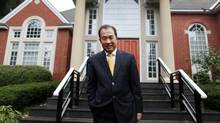 Zhang Junsai, China's ambassador to Canada, poses at his Ottawa residence. (Dave Chan FOR THE GLOBE AND MAIL)